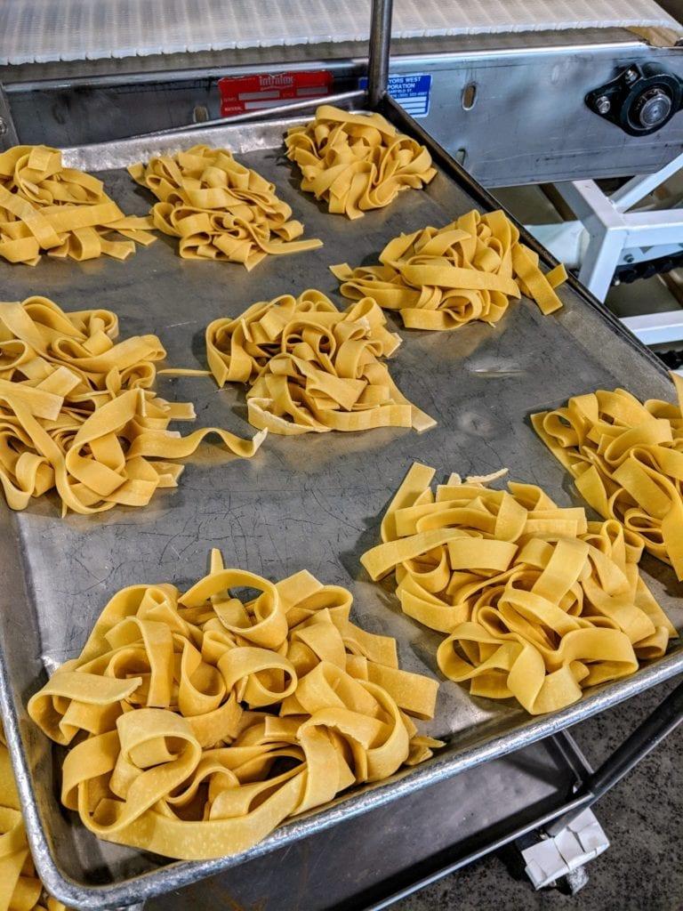Grandma's frozen pasta freshly made on a metal sheet pan